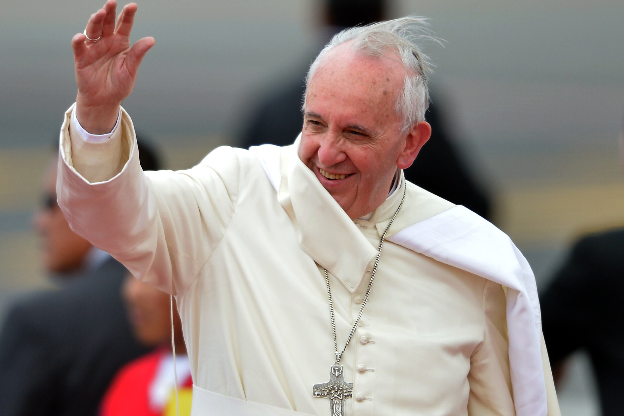 Pope Francis waves at the airport in Quito before his departure for Bolivia, on July 8, 2015. Pope Francis, the first Latin American pontiff, heads Wednesday to Bolivia on the second leg of a three-nation tour of the continent's poorest countries, where he has been acclaimed by huge crowds.     AFP PHOTO / MARTIN BERNETTIMARTIN BERNETTI/AFP/Getty Images