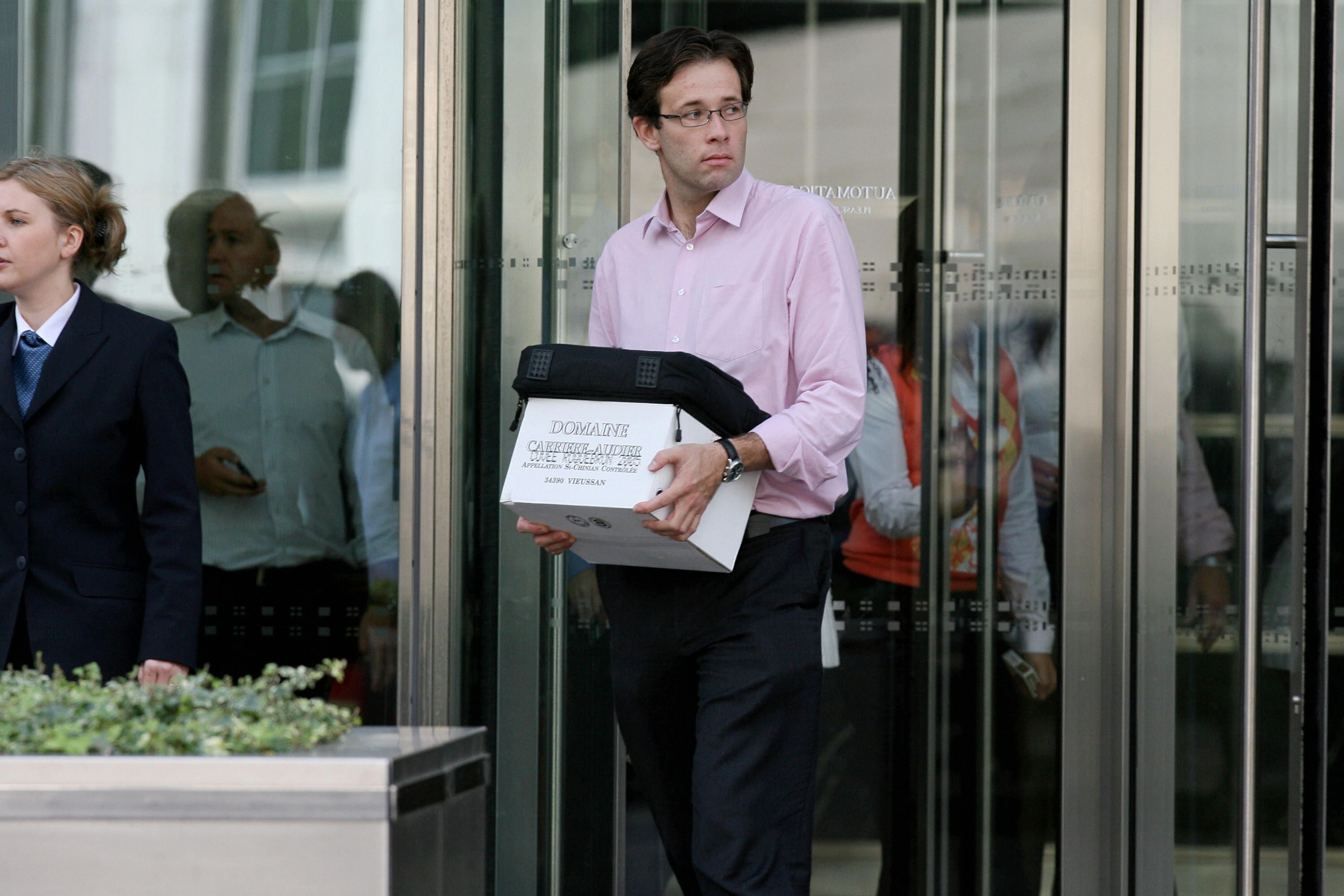A man carrying a box leaves the Lehman Brothers European Headquarters building in Canary Wharf in east London, on September 15, 2008. The British arm of US investment giant Lehman Brothers has been put into administration, accountancy firm PriceWaterhouseCoopers said Monday. AFP PHOTO/Ben Stansall (Photo credit should read BEN STANSALL/AFP/Getty Images)